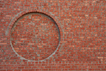 Red Brick Wall With A Round Niche
