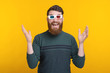 Amazed man with beard wearing 3D glasses