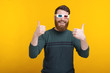 Photo of bearded man showing thumbs up and wearing 3D glasses