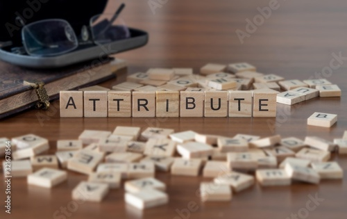 Photo attribute concept represented by wooden letter tiles