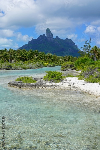 View of the Mont Otemanu mountain reflecting in water in Bora Bora, French Polynesia, South Pacific