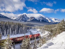 Train On Morant's Curve January In Banff National Park, Alberta, Canada. Morant's Curve Is A Scenic Spot 4 Kilometers East Of Lake Louise On The Old Highway.