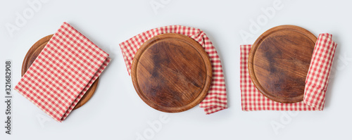 Round pizza board with red checked tablecloth collection on white background Fotobehang
