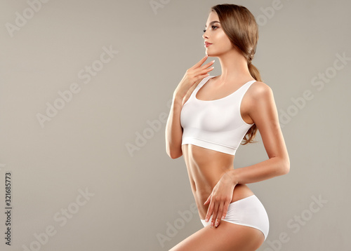 Perfect slim toned young body of the girl Fototapet