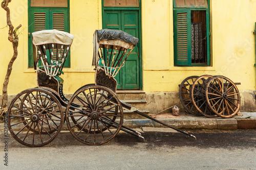 Hand pulled rickshaws are parkedon the street. Kolkata. India Tapéta, Fotótapéta
