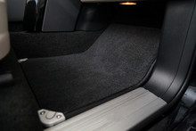 Clean Car Floor Mats Of Black Carpet Under Front Passenger Seat In The Workshop For The Detailing Vehicle Before Dry Cleaning. Auto Service Industry. Interior Of Sedan.