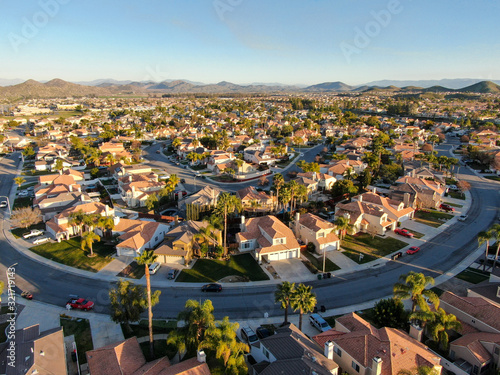 Leinwand Poster Aerial view of Menifee neighborhood, residential subdivision vila during sunset