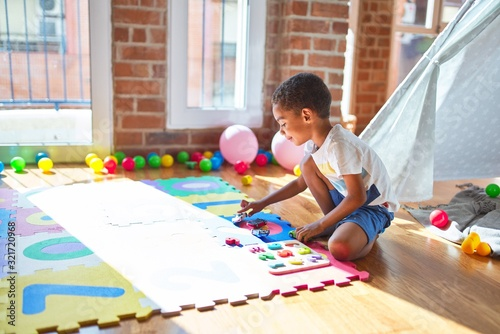 Obraz Beautiful african american toddler playing with maths game and cars at kindergarten - fototapety do salonu
