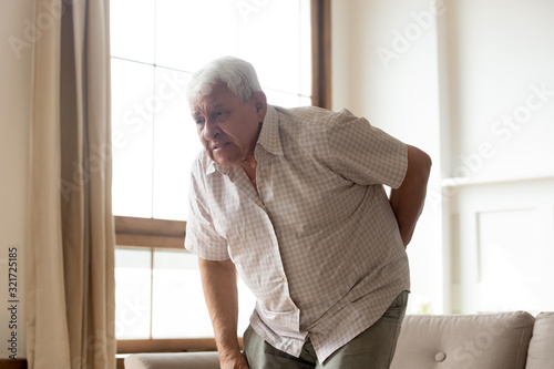 Unhealthy mature man suffering from rheumatism pain Canvas Print