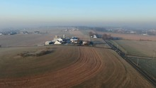 American Farm In Winter Morning, Aerial View Of Rural Landscape Engulfed In Mist, Aerial View