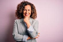 Middle Age Beautiful Businesswoman Wearing Elegant Jacket Over Isolated Pink Background Looking Confident At The Camera Smiling With Crossed Arms And Hand Raised On Chin. Thinking Positive.