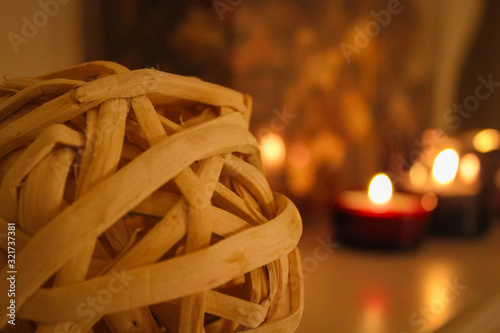 Romantic atmosphere. Rattan balls and candles