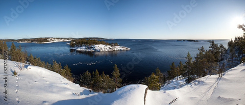 Obraz na plátně Panorama of the skerries of Lake Ladoga in winter sunny day