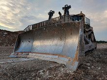 Muddy Caterpillar D11 Bulldozer - Blade Detail At Sunset