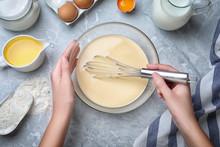 Woman Preparing Batter For Thin Pancakes At Grey Table, Top View