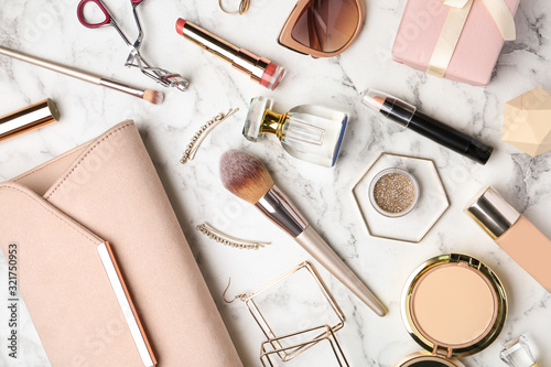 Fototapeta Flat lay composition with different luxury makeup products and accessories on white marble table obraz
