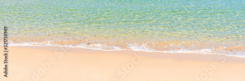 Fototapeta tropical beach and sea with wave reaching coast, summer travel and vacation concept, background obraz