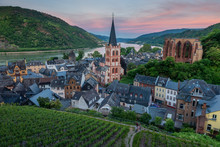 High Angle View Of Parish Church Of St. Peter Surrounded By Local Dwellings With Grape Plantation Foreground At Bacharach, Germany During Sunset