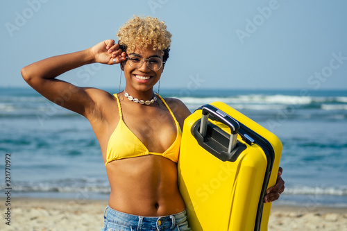 happy mixed race hispanic brazil woman in yellow swimming suit bra and demin sho Canvas Print