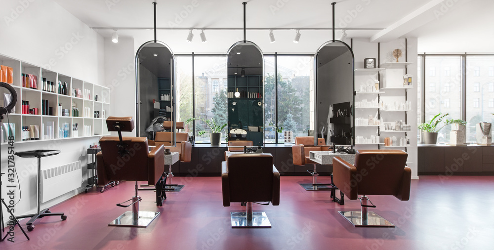 Fototapeta Chairs and mirrors in modern hairdressing, beauty salon