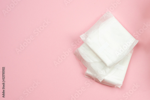 Woman pads lying on  pink  background Canvas Print