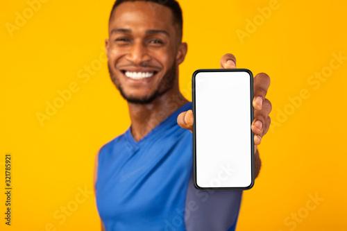 Black millennial gman showing white blank phone Fototapet