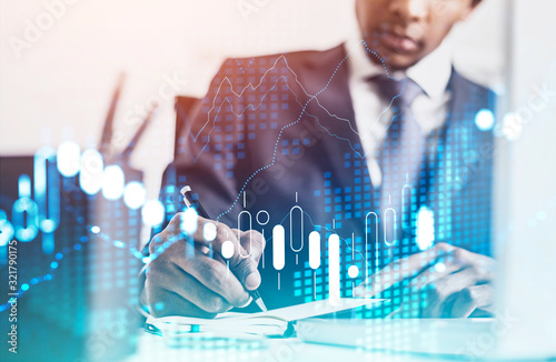 Fototapeta African businessman in office, financial chart obraz