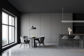 Gray kitchen interior with bar and table