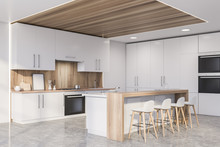Corner Of Wooden Kitchen With Countertops And Bar