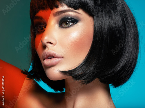 Fototapeta Glamour fashion model with black gloss make-up