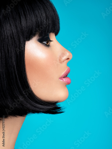 Obraz Glamour fashion model with black gloss make-up. Beautiful fashion woman with a bob hairstyle. Attractive white girl with black eye-makeup.  Stylish fashionable concept. Art. - fototapety do salonu