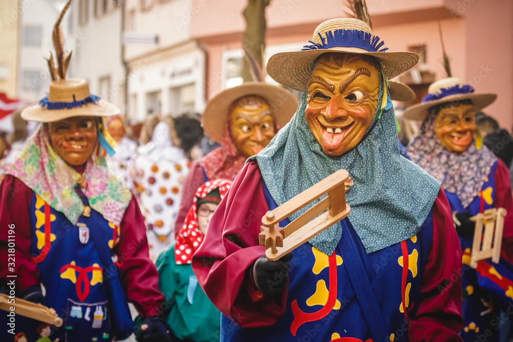 Fototapeta Festival participants dressed up in handmade costume and mask at the Ulmzug carnival event in Ulm, Germany