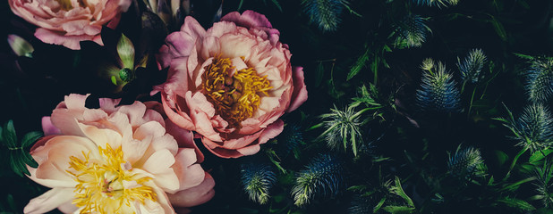 Vintage bouquet of peonies on black. Floristic decoration. Floral background. Baroque old fashiones style image. Natural flowers pattern wallpaper or greeting card