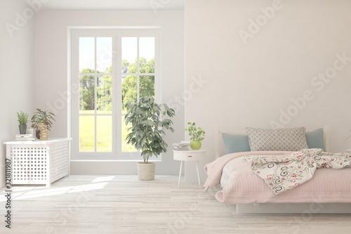 Fotografija Stylish bedroom in white color with summer landscape in window