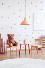 Brown Teddy Bear On Wooden Cha...