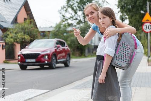 Fototapeta Careful mom and daughter