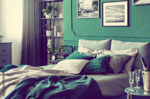 Cozy bed with pillows and blankets in emerald and grey colors Fototapet