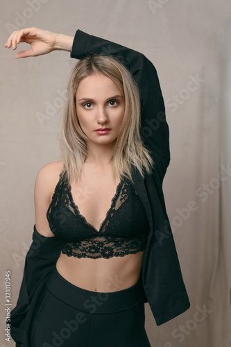 Photo Sexy young blond woman in black lingerie