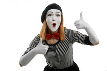 Female Mime Shows Thumbs Up Of Both Hands