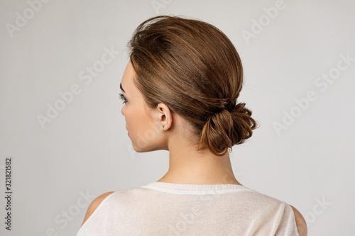 cute woman with beautiful elegant hair bun on gray background Canvas Print