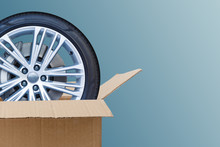 Open Cardboard Box With Tires ...