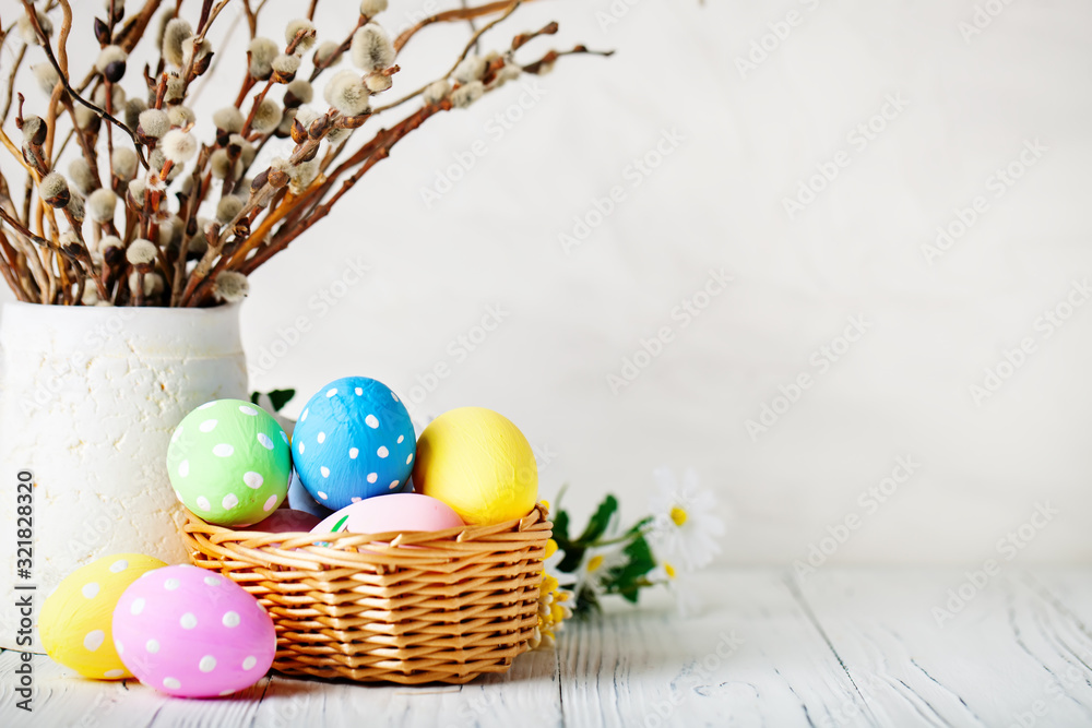 Fototapeta Happy Easter. Congratulatory easter background. Easter eggs and flowers. Background with copy space. Selective focus.