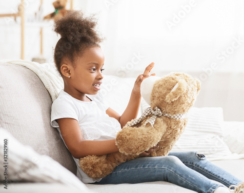 Valokuva Adorable black little girl playing with toys at home