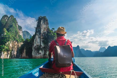Man traveler on boat look nature rock island scenic adventure landscape Khao Sok National park, Attraction landmark tourist travel Thailand, Tourism beautiful destinations Asia holidays vacation trips