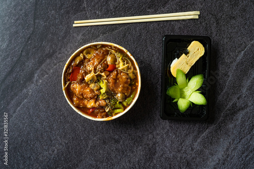Take Away Shanghai Style Sea Bass Fish Fillets Food and Japanese Dashimaki Tamago made from Egg Sushi Marinated with Dashi Soup Mirin, Shoyu, Flower Shaped Cucumber in Plastic Box / Package Wallpaper Mural