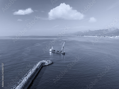 Fényképezés Aerial view from the drone of a dredging vessel seabed