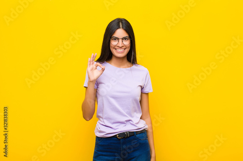 Photo young pretty latin woman feeling happy, relaxed and satisfied, showing approval
