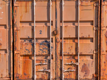 Old Rusty Orange Shipping Container Door Side.