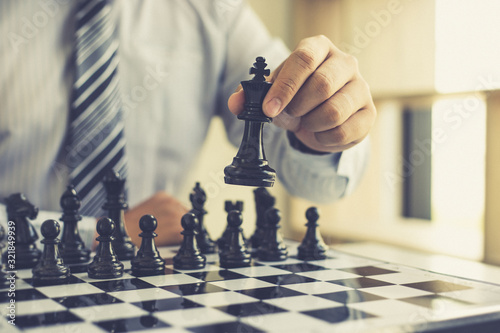 Fotomural Business strategy, Businessman have the skills to play chess and be successful, management or leadership concept