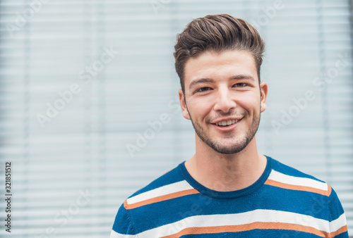 Tablou Canvas Smiling closeup young  man with positive face expression
